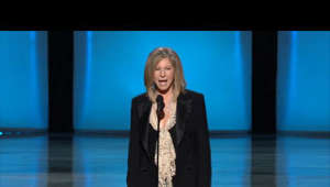 Barbra Streisand wearing a suit and tie: Barbra Streisand presenting the Oscar for Directing to Kathryn Bigelow for The Hurt Locker at the 82nd Academy Awards.