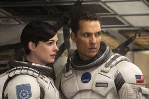 Anne Hathaway, Matthew McConaughey are posing for a picture: The power of film can send you to places you never thought possible—including outer space. If you're looking for an escape, a journey to another planet is an exciting option. Here are some of the best films set far away from planet Earth.