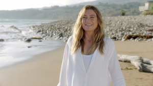 Ellen Pompeo smiling next to a body of water: 'Grey's Anatomy' (ABC)