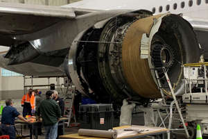 The damaged starboard engine of United Airlines flight 328, a Boeing 777-200, is seen following a February 20 engine failure incident, in a hangar at Denver International Airport in Denver, Colorado, U.S. February 22, 2021. National Transportation Safety Board/Handout via REUTERS.  THIS IMAGE HAS BEEN SUPPLIED BY A THIRD PARTY. THIS IMAGE WAS PROCESSED BY REUTERS TO ENHANCE QUALITY, AN UNPROCESSED VERSION HAS BEEN PROVIDED SEPARATELY.  MANDATORY CREDIT