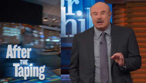 Phil McGraw wearing a suit and tie