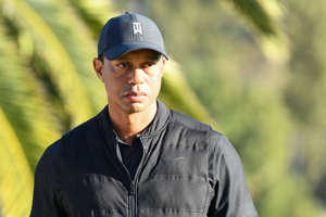 PACIFIC PALISADES, CA - FEBRUARY 21: Tiger Woods looks on from the 18th hole during the final round of The Genesis Invitational golf tournament at the Riviera Country Club in Pacific Palisades, CA on February 21, 2021. The tournament was played without fans due to the COVID-19 pandemic.(Photo by Brian Rothmuller/Icon Sportswire via Getty Images)