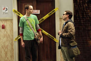 Jim Parsons standing in front of a building: A plot hole is defined as any