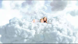 a person in a blue cloudy sky: Clouds is Out Now: Slayyyter.lnk.to/Clouds Pre-Save the album now: Slayyyter.lnk.to/troubled-paradise  FOLLOW SLAYYYTTER  Instagram: https://www.instagram.com/slayyyter/  Twitter: https://twitter.com/slayyyter  Tik Tok: https://tiktok.com/@slayyyter   CREDITS: Directed by Munachi Osegbu Produced by Collin Druz Heather Heller - EP DP - Taylor Randall AD - Jonas Morales Gaffer - Ronnie Gotch PD - Ava Jones VFX - Jakob Thorhassel  LYRICS: I always dreamed to the sound of a drum Little girl won the world, she's a champion Nice champagne on ice Life is paradise So tell me why I feel this way inside?  I'm unhappier than I've ever been I never thought I'd know what it's like to win Say what you want but I never thought I'd end up here Some days I feel good then I really wanna disappear I always got clouds over me I always got clouds over me  I wish they knew what goes on in my head Sometimes feels like I'd be better off dead I don't wanna think Pour another drink So I don't have to feel anything  I'm unhappier than I've ever been I never thought id know what it's like to win  Say what you want but I never thought I'd end up here Some days I feel good then I really wanna disappear I always got clouds over me I always got clouds over me  Oh Woah Oh Uhh!