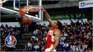 a man holding a basketball: Standing just 5-foot-7, the Atlanta Hawks' Spud Webb shocked the world by beating teammate Dominique Wilkins to win the 1986 NBA Slam Dunk Contest.  ✔ Subscribe to ESPN on YouTube: http://es.pn/SUBSCRIBEtoYOUTUBE ✔ Watch Latest Episodes on WatchESPN: http://es.pn/LatestEpisodes ✔ Watch ESPN on YouTube TV: http://es.pn/YouTubeTV  Get more ESPN on YouTube: ► First Take: http://es.pn/FirstTakeonYouTube ► SC6 with Michael & Jemele: http://es.pn/SC6onYouTube ► SportsCenter with SVP: http://es/pn/SVPonYouTube  ESPN on Social Media: ► Follow on Twitter: http://www.twitter.com/espn ► Like on Facebook: http://www.facebook.com/espn ► Follow on Instagram: http://www.instagram.com/espn  Visit ESPN on YouTube to get up-to-the-minute sports news coverage, scores, highlights and commentary for NFL, NHL, MLB, NBA, College Football, NCAA Basketball, soccer and more.   More on ESPN.com: http://www.espn.com