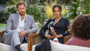 Prince Harry, Meghan Markle sitting on a bench: UNSPECIFIED - UNSPECIFIED: In this handout image provided by Harpo Productions and released on March 5, 2021, Oprah Winfrey interviews Prince Harry and Meghan Markle on A CBS Primetime Special premiering on CBS on March 7, 2021. (Photo by Harpo Productions/Joe Pugliese via Getty Images)