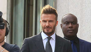 David Beckham wearing a suit and tie