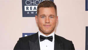 Colton Underwood wearing a suit and tie