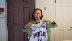 a person standing posing for the camera: Lili Gu's 94-year-old grandma recently discovered a love of basketball. One of her favorite NBA players took notice and sent her a surprise.