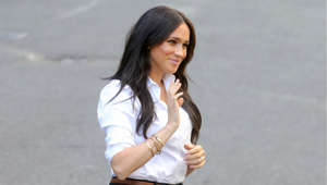 Meghan Markle standing in a parking lot