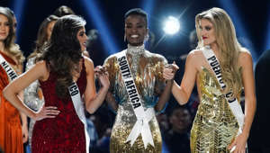 Madison Anderson, of Puerto Rico, Miss Universe 2019 Zozibini Tunzi, of South Africa, and Sofia Aragon, of Mexico, the final three contestants hold hands in the Miss Universe pageant at Tyler Perry Studios in Atlanta, Georgia, U.S. December 8, 2019.  REUTERS/Elijah Nouvelage