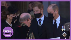 a person wearing a suit and tie: 'Prince Harry and William Walk Together as Royal Family Departs Prince Philip's Funeral'  Prince William and his brother, Prince Harry, were seen walking together through the grounds of Windsor Castle following the funeral of their grandfather, Prince Philip, the Duke of Edinburgh, on Saturday.