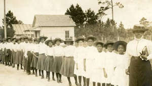 a group of people posing for a photo: Mary McLeod Bethune taught black girls they could be more