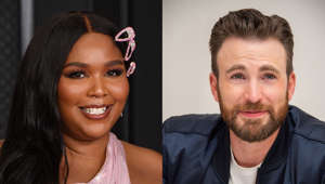 Lizzo, Chris Evans posing for the camera