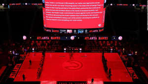a screenshot of a computer: ATLANTA, GEORGIA - APRIL 20: The Atlanta Hawks and Orlando Magic observe the guilty verdicts in the Derek Chauvin case prior to the game at State Farm Arena on April 20, 2021 in Atlanta, Georgia. NOTE TO USER: User expressly acknowledges and agrees that, by downloading and or using this photograph, User is consenting to the terms and conditions of the Getty Images License Agreement. (Photo by Kevin C. Cox/Getty Images)