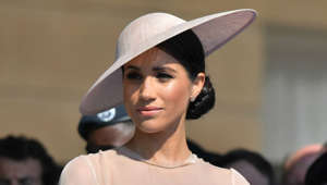 a close up of Meghan Markle wearing a hat