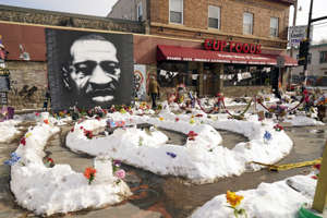 a large cake covered in snow: A mural of George Floyd is seen in George Floyd Square in Minneapolis. (Jime Mone / Associated Press)