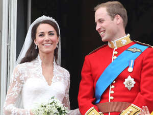 Prince William, Duke of Cambridge and woman posing for a picture: Prince William and Kate Middleton at their 2011 Royal Wedding