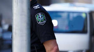 a close up of a man in a car: SA Police charged a42-year-old man after being called to a home in Clare. (ABC News: Michael Clements)