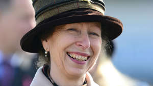a close up of Anne, Princess Royal wearing a hat