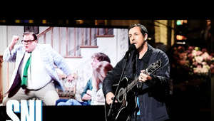 a person holding a microphone: Adam Sandler sings a tribute to his friend and Saturday Night Live alum Chris Farley.  #SNL #AdamSandler #ShawnMendes #SNL44  Subscribe to SNL: https://goo.gl/tUsXwM Stream Current Full Episodes: http://www.nbc.com/saturday-night-live  Watch Past SNL Seasons:  Google Play - http://bit.ly/SNLGooglePlay  iTunes - http://bit.ly/SNLiTunes  Follow SNL Social - SNL Instagram: http://instagram.com/nbcsnl  SNL Facebook: https://www.facebook.com/snl SNL Twitter: https://twitter.com/nbcsnl SNL Tumblr: http://nbcsnl.tumblr.com/ SNL Pinterest: http://www.pinterest.com/nbcsnl/