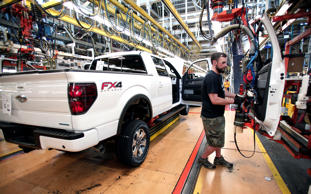 Ford worker Dan Fortune performs a door install on a new 2014 Ford F-150 truck on the assembly line at the Ford Dearborn Truck Plant June 13, 2014 in Dearborn, Michigan. Production for the 2015 model F-150 at the plant is expected to begin in the 4th quarter of this year.