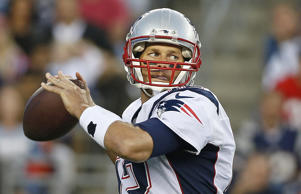 New England Patriots quarterback Tom Brady prepares to throw a pass against the ...