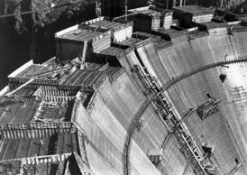1934: Construction continues on Hoover Dam, holding back the waters of the Colorado River between Arizona and Nevada to create power and Lake Mead.