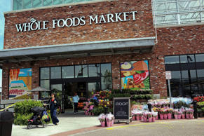 People walk out of  Whole Foods Market in the Brooklyn borough in New York City.