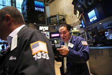 Traders work on the floor of the New York Stock Exchange (NYSE) on August 1, 2014 in New York City. Spencer Platt/Getty Images