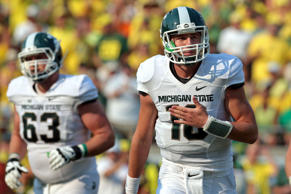 Michigan State Spartans quarterback Connor Cook (18) returns to the side line following a missed throw in the first half against the Oregon Ducks at Autzen Stadium on Sept. 6 in Eugene, Ore.