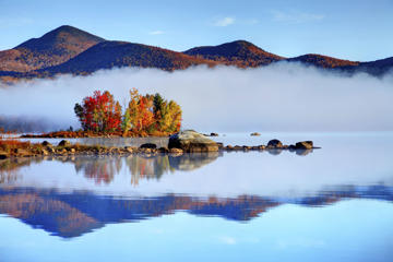 Autumn foliage reflecting on the a lake in Vermont