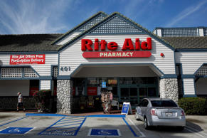 A car sits parked outside of a Rite Aid Corp. store in Redondo Beach, California, U.S., on Wednesday, April 9, 2014.