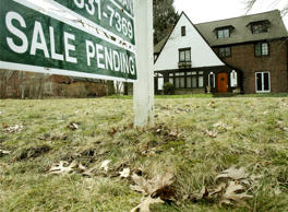 This Friday, March 21, 2014 file photo shows a home for sale in Shaker Heights, Ohio. Freddie Mac releases weekly mortgage rates on Thursday, June 26, 2014.