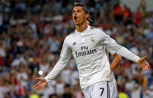 Real Madrid's Cristiano Ronaldo celebrates after scoring a goal against Elche during their Spanish first division soccer match at Santiago Bernabeu stadium in Madrid on Sept. 23.