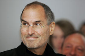 Apple Chief Executive Steve Jobs looks at the crowds at the grand opening of the...