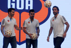 Bollywood actor Varun Dhawan with Co-owner of club and cricketer Virat Kohli and French footballer and marquee player Robert Pires during a press conference in Mumbai, India.