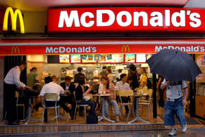 Customers are seen sitting at tables at a McDonald and apos;s restaurant in Tokyo, Tuesday, 18 July, 2006.