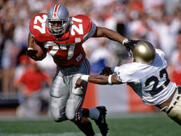 The senior running back edged Nebraska's Tommie Frazier to capture the trophy. G...
