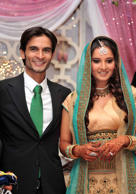 In this  photograph released by Sania Mirza's family  India's tennis star Sania Mirza is seen with her childhood friend and fiance Sohrab Mirza,left, after their engagement ceremony, in Hyderabad, India, Friday, July 10, 2009.