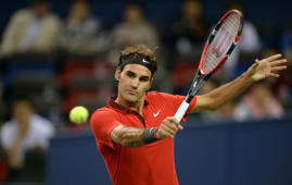 Roger Federer of Switzerland hits a return against Leonardo Mayer of Argentina during their men's singles second round match at the Shanghai Masters 1000 tennis tournament held in the Qizhong Tennis Stadium in Shanghai on October 8, 2014.