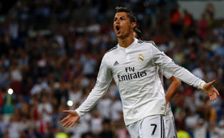Real Madrid's Cristiano Ronaldo celebrates after scoring a goal against Elche du...