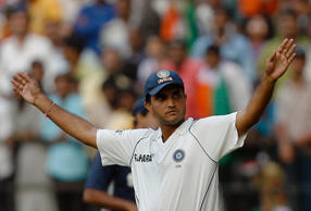 India's Saurav Ganguly gestures towards the crowd as he arrives on the ground for fielding during the fourth test cricket match against Australia in Nagpur November 9, 2008. Ganguly has announced his retirement after this test match.