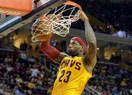Cavaliers forward LeBron James dunks in the third quarter against the Mavericks on Oct. 17 in Cleveland.