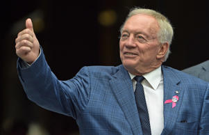 Owner Jerry Jones of the Dallas Cowboys gives the 'thumbs up' to some Cowboys fa...