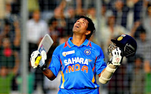 Sachin Tendulkar reacts after scoring his 100th international century during a one day game against Bangladesh in Dhaka.