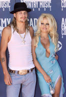 Singer Kid Rock (L) and actress Pamela Anderson pose as they arrive at the 37th annual Academy of Country Music Awards in Los Angeles in this May 22, 2002 file photograph. Kid Rock and Pamela Anderson have announced plans to marry according to 'US' magazine July 18, 2006. //
