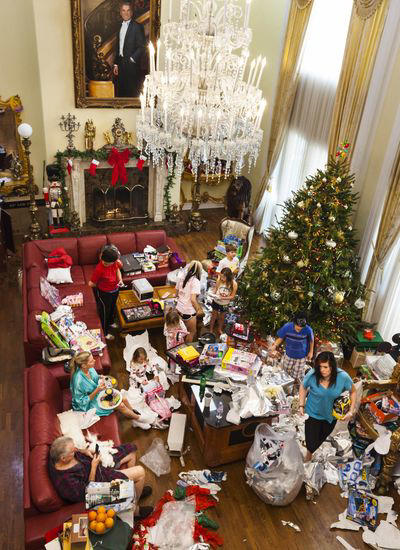 Jackie Siegel eats caviar on Christmas morning in Windermere, Fla., in 2010 as her family opens the presents she bought. To curtail her spending, Jackie gave her husband David unopened board games they had received as gifts and bought dozens of toys for the children at Wal-Mart.