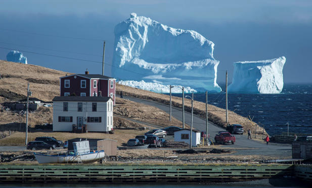 "Slide 1 of 19: Residents view the first iceberg of the season as it passes the South Shore, also known as ""Iceberg Alley"", near Ferryland Newfoundland, Canada April 16, 2017. Picture taken April 16, 2017. REUTERS/Greg Locke TPX IMAGES OF THE DAY"