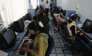 Employees at a call centre provide service support to customers in the northeastern Indian city of Siliguri February 2, 2008. A third undersea cable was cut on Friday, just two days after two breaks near Egypt disrupted Web access in parts of the Middle East and Asia, Indian-owned cable network operator FLAG Telecom said.